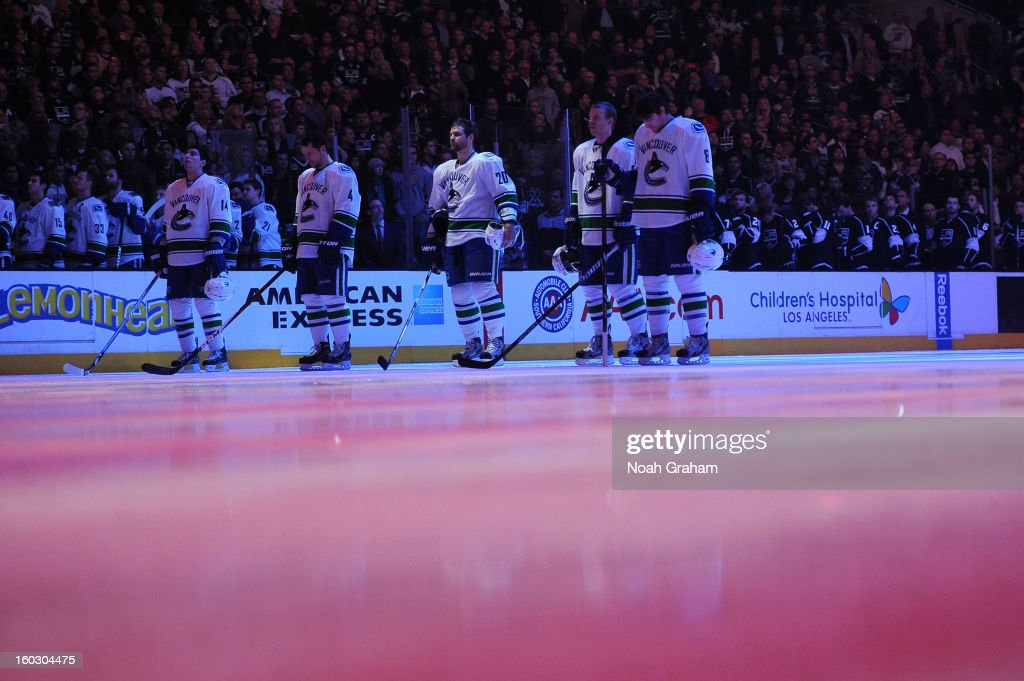 The Vancouver Canucks stand on the ice prior to the game against the Los Angeles Kings at Staples Center on January 28, 2013 in Los Angeles, California.