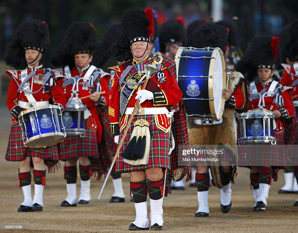 The Vancouver Police Pipe Band perform in the Household Division's Beating Retreat, watched by Prince William, Duke of Cambridge on Horse Guards Parade on June 12, 2014 in London, England.