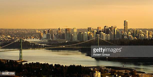 The Vancouver skyline Burrard Inlet and Lion's Gate bridge is pictured at sunset February 17 2009 in Vancouver British Columbia Canada Vancouver is...