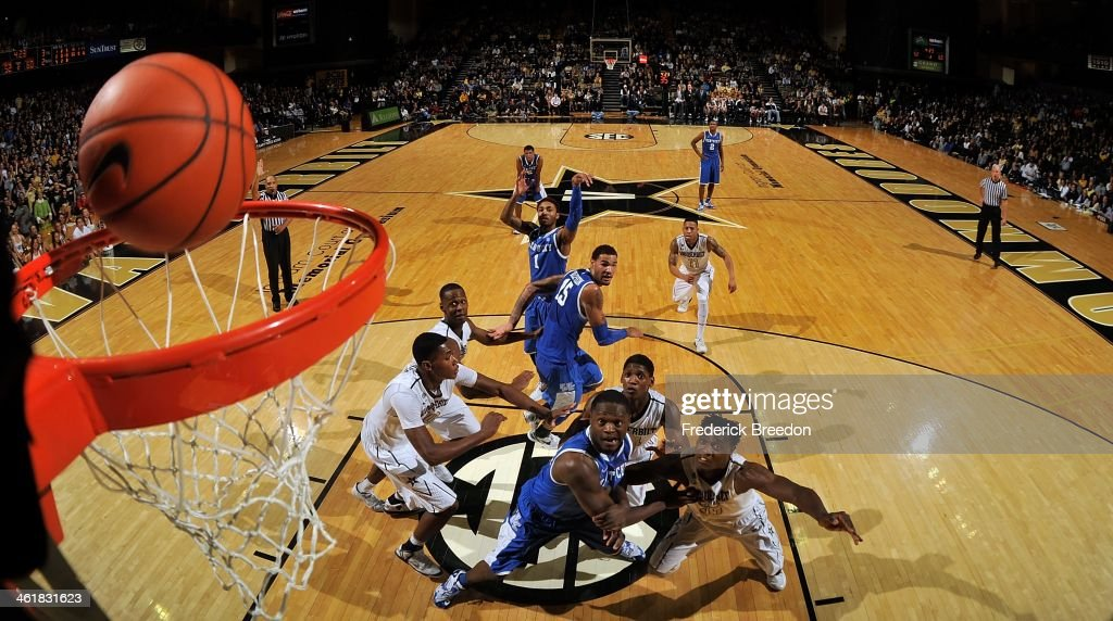 The Vanderbilt Commodores and the Kentucky Wildcats watch a shot by James Young #1 drop in the basket at Memorial Gym on January 11, 2014 in Nashville, Tennessee.