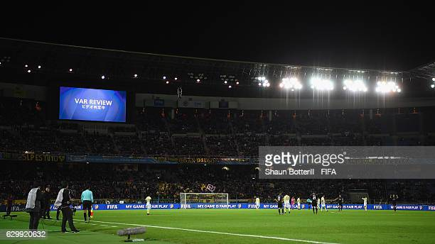 The VAR review is shown on the large screen during the FIFA Club World Cup semi final match between Club America and Real Madrid at International...