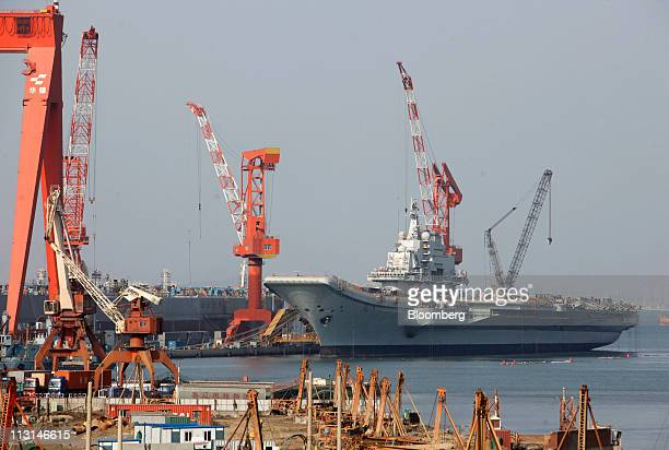 The Varyag a Russian built aircraft carrier sits docked in Dalian Liaonin Province China on Saturday April 23 2011 China's shipping industry was...