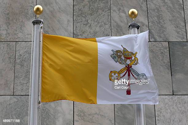 The Vatican flag flies outside the United Nations headquarters on September 25 2015 in New York City Pope Francis is in New York on a two day visit...