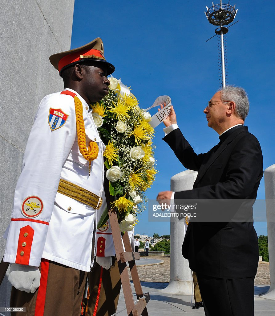 The Vatican Secretary for Relations with States, Monsignor Dominique Francois Joseph Mamberti (R), places a wreath at Jose Marti monument in Havana on June 16, 2010. Mamberti is in a five-day official visit to the island. AFP PHOTO/Adalberto ROQUE