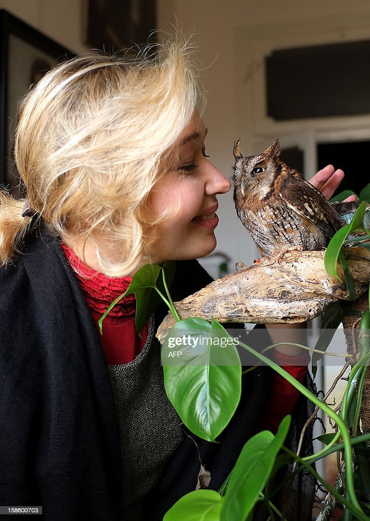 The Vatican's newest official court artist Natalia Tsarkova poses with her pet owl on December 18, 2012 in her studio by Rome. After Michelangelo and Raphael, the Vatican's newest official court artist is something of an unusual choice -- an ebullient Russian woman with a pet owl who meets cardinals and popes on a daily basis.