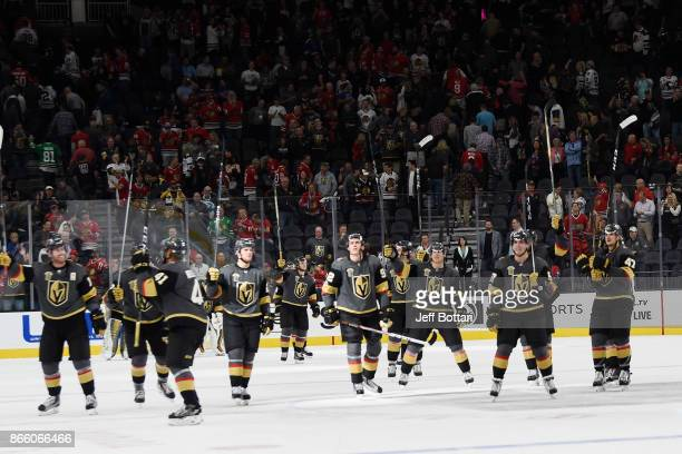 The Vegas Golden Knights celebrate after defeating the Chicago Blackhawks at TMobile Arena on October 24 2017 in Las Vegas Nevada