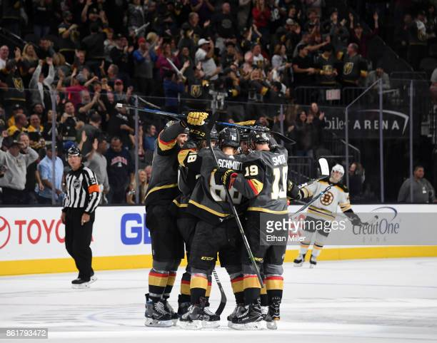 The Vegas Golden Knights celebrate after Oscar Lindberg scored an emptynet goal against the Boston Bruins in the third period of their game at...