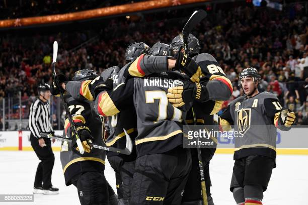 The Vegas Golden Knights celebrate after scoring a goal against the Chicago Blackhawks during the game at TMobile Arena on October 24 2017 in Las...
