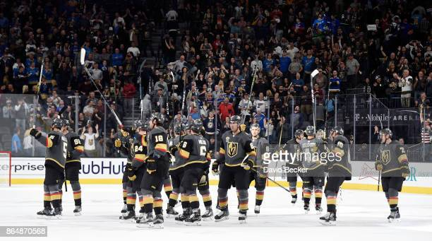 The Vegas Golden Knights celebrate after their overtime win against the St Louis Blues at TMobile Arena on October 21 2017 in Las Vegas Nevada The...