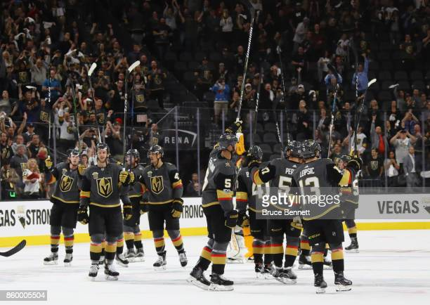 The Vegas Golden Knights celebrate their 52 victory over the Arizona Coyotes during the Golden Knights' inaugural regularseason home opener at...