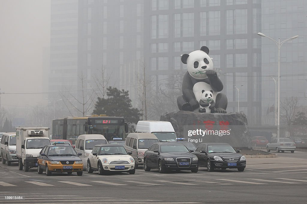 The vehicles are seen near a panda sculpture during severe pollution on January 23, 2013 in Beijing, China. The air quality in Beijing on Wednesday hit serious levels again, as smog blanketed the city.