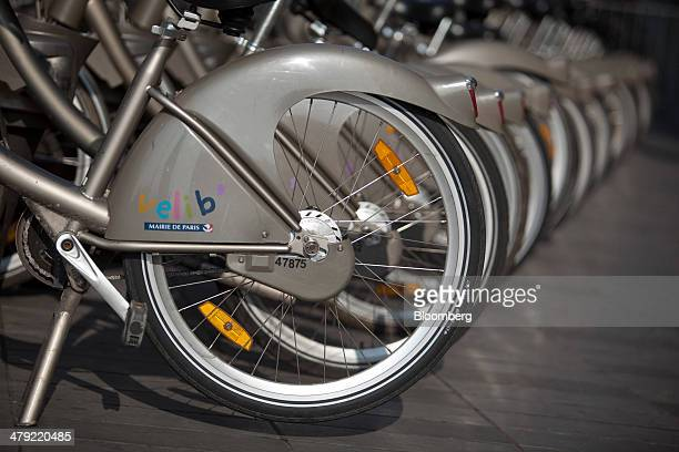 The Velib' logo is seen on the mud guards of bicycles as they sit in a public bikesharing scheme bicycle rack in Paris France on Thursday March 13...