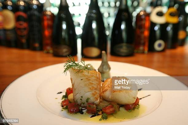 The velvety panseared black cod and Merlot wine at Travertino The Oberoi