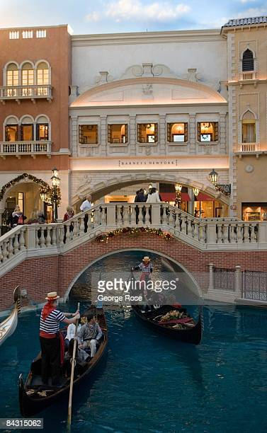 The Venetian Hotel located on the famed Las Vegas Strip features an Italianthemed shopping mall based on replicas of the canals of Venice Italy as...