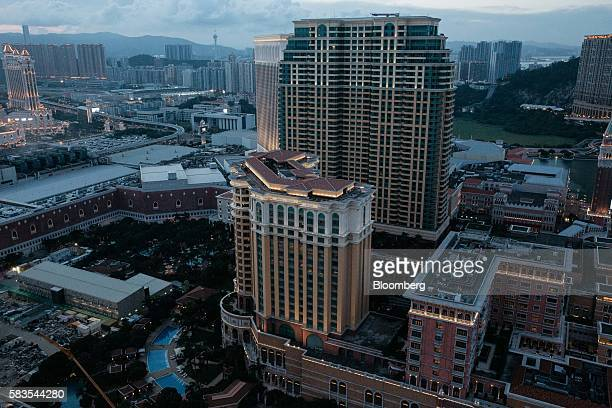The Venetian Macao resort and casino operated by Sands China Ltd is seen from the Parisian's Eiffel Tower attraction in Macau China on Tuesday July...