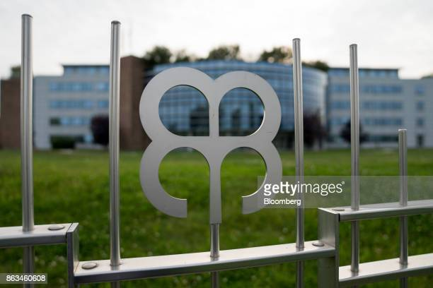 The Veneto Banca company logo sits on gates outside the former headquarters office of Veneto Banca SpA now operated by Intesa Sanpaolo SpA in...