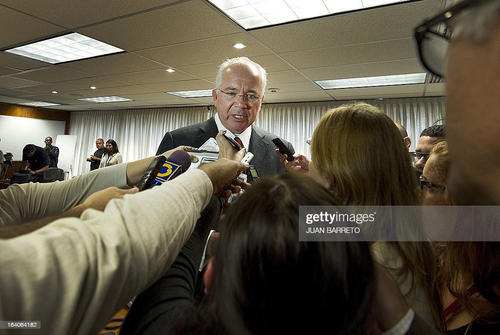 The Venezuelan Minister of Energy and Mines and also President of the state owned oil company PDVSA Rafael Ramirez, speaks with some reporters after giving a press conference in Caracas on March 19, 2013. AFP PHOTO
