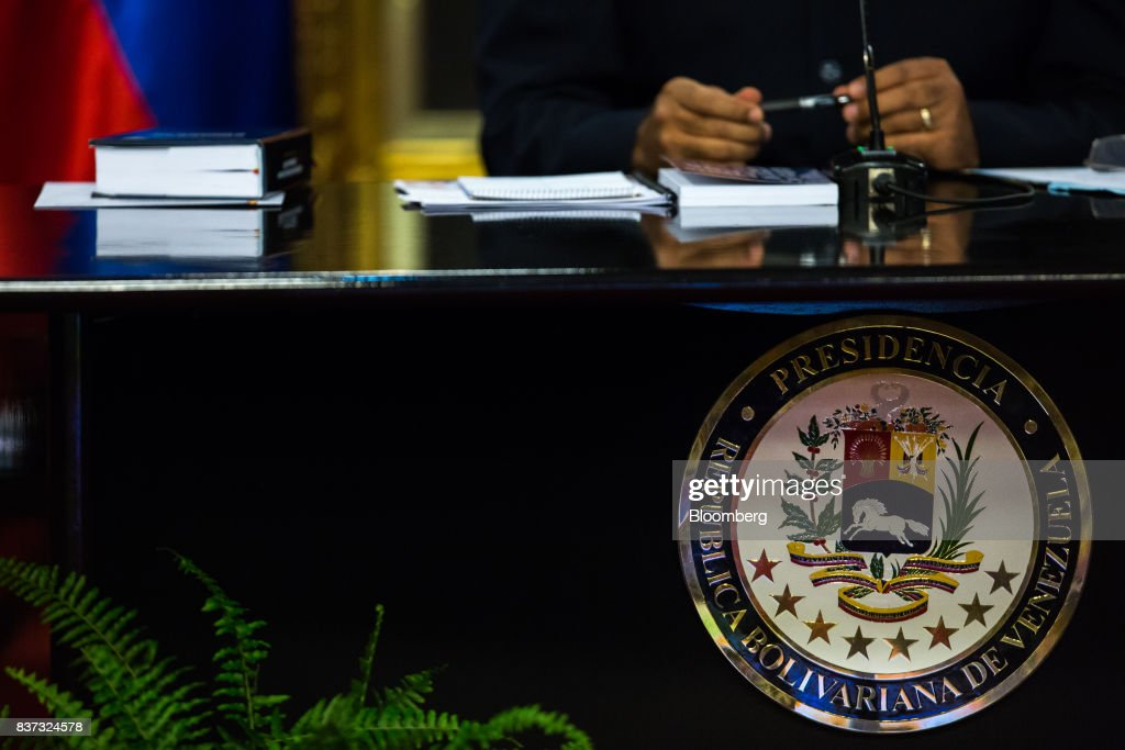 The Venezuelan presidential seal is seen during a news conference in Caracas, Venezuela, on Tuesday, Aug. 22, 2017. President Nicolas Maduro said Venezuela's authoritarian regime is prepared for additional retaliation from the U.S., one of the crisis-torn nation's principal trade partners, including wide-reaching sanctions on its beleaguered economy and oil industry. Photographer: Wil Riera/Bloomberg via Getty Images