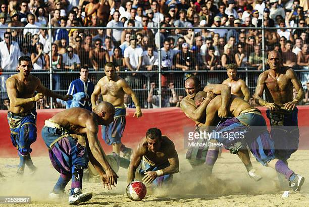 The Verdi team and the Azzurri team battle for possession during the Calcio Storico a medieval football rules event held between four quarters of...