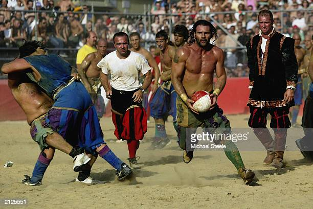 The Verdi team and the Azzurri team in action during the Calcio Storico a medieval football rules event held between four quarters of Florence since...