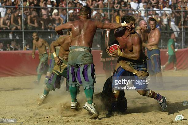 The Verdi team and the Azzurri team in action during the Calcio Storico a medieval football rules event held between the four quarters of Florence...