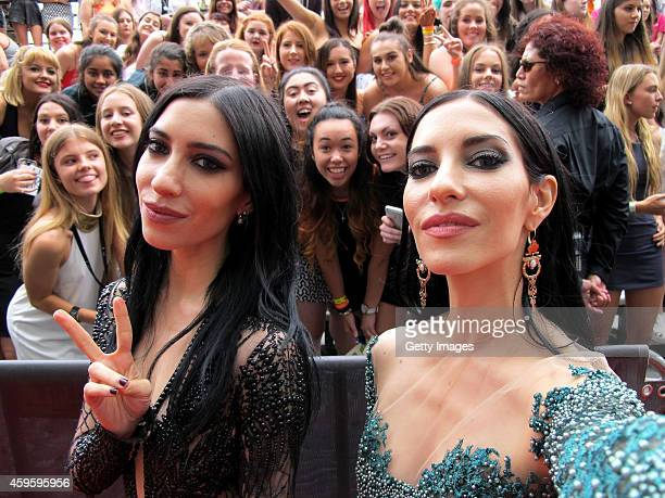 The Veronicas Jessica and Lisa Origliasso takes a selfie with fans upon arrival for the 28th Annual ARIA Awards 2014 at the Star on November 26 2014...