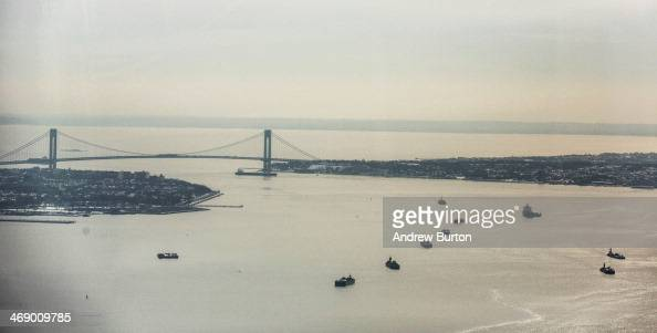 The VerrazanoNarrows Bridge and New York Harbour are seen from the 100th floor of One World Trade Center on February 12 2014 in New York City The...