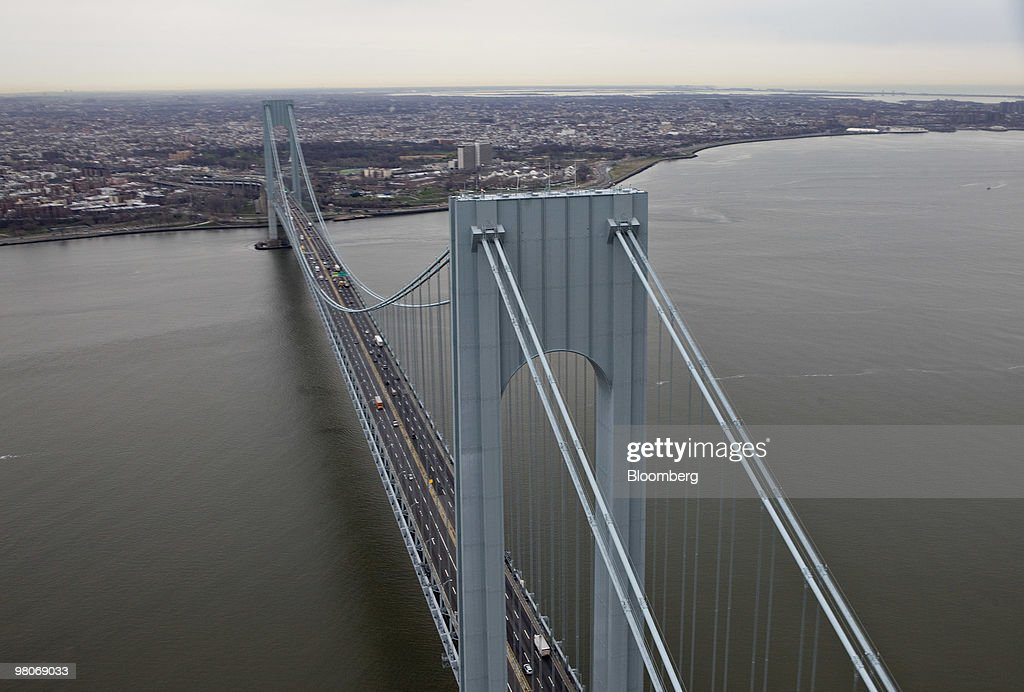 The Verrazano-Narrows Bridge leads into Brooklyn as viewed from an A-star 350 B-2 helicopter made by Eurocopter SA, one of six in the fleet of Liberty Helicopters Inc., as it flies over New York Harbor in New York, U.S., on Thursday, March 25, 2010. Liberty Helicopters Inc. is offering to fly weary commuters from New Jersey to Manhattan for about $200 a day, saving them 14 hours in traffic a week and signaling that Wall Street may have seen the worst of the recession. Photographer: Daniel Acker/Bloomberg via Getty Images