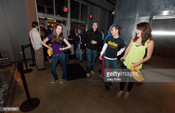 The very first fans to enter the new venue joke around as they pose for a photo on December 3 2010 in Pittsburgh Pennsylvania