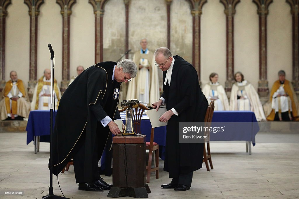 The Very Reverend Dr Robert Willis (C) oversees the formal sealing of documents by Brigadier John Meardon, The Receiver General, (L) following the election of Justin Welby as the new Archbishop of Canterbury, on January 10, 2013 in Canterbury, England. The College of Canons met today inside the 14th century Chapter House at Canterbury Cathedral to elect the new Archbishop after receiving the 'Conge d' Elire' and 'Letter Missive' from the Crown authorising the election to take place. Welby, currently the Bishop of Durham, will take over from Dr Rowan Williams, the 104th Archbishop of Canterbury, who stepped down from the position on December 31, 2012.