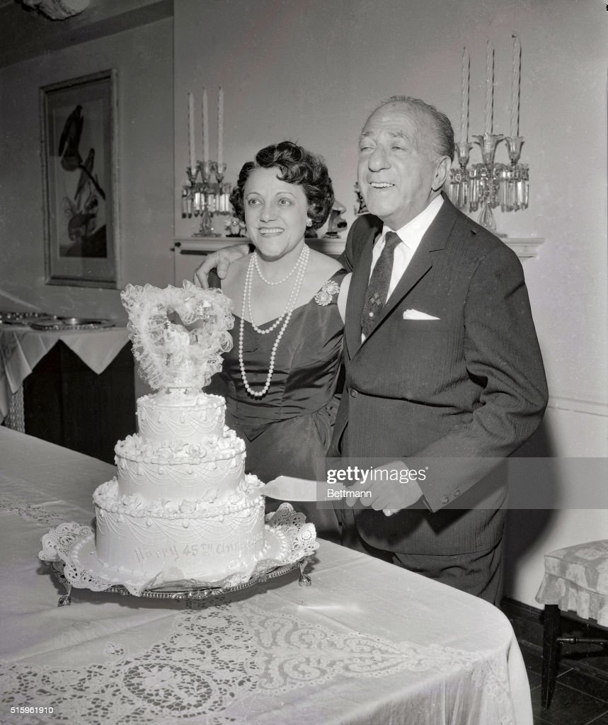 The veteran band leader Ted Lewis slices the cake with his wife Adah as they celebrate their 45th wedding anniversary It is also Ted Lewis's 50th...