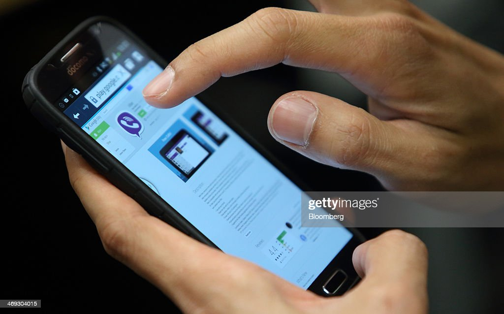 The Viber Internet messaging and calling service application is downloaded on a smartphone in this arranged photograph taken in Tokyo, Japan, on Friday, Feb. 14, 2014. Rakuten Inc., the Japanese online retailer controlled by billionaire Hiroshi Mikitani, is buying the Viber Internet messaging and calling service for $900 million as it moves into social networking. Photographer: Tomohiro Ohsumi/Bloomberg via Getty Images