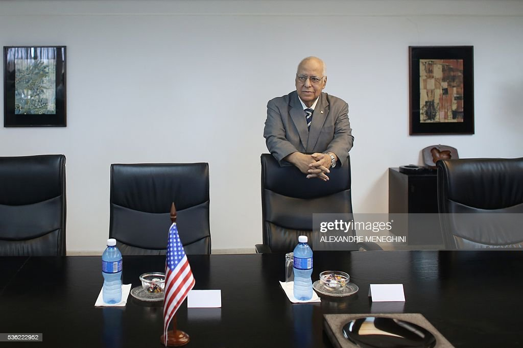 the Vice-President of Cuba's Council of Ministers Ricardo Cabrisas Ruiz waits to meet with Missouri's Governor Jay Nixon (out of frame) in Havana on May 31, 2016. / AFP / POOL / ALEXANDRE