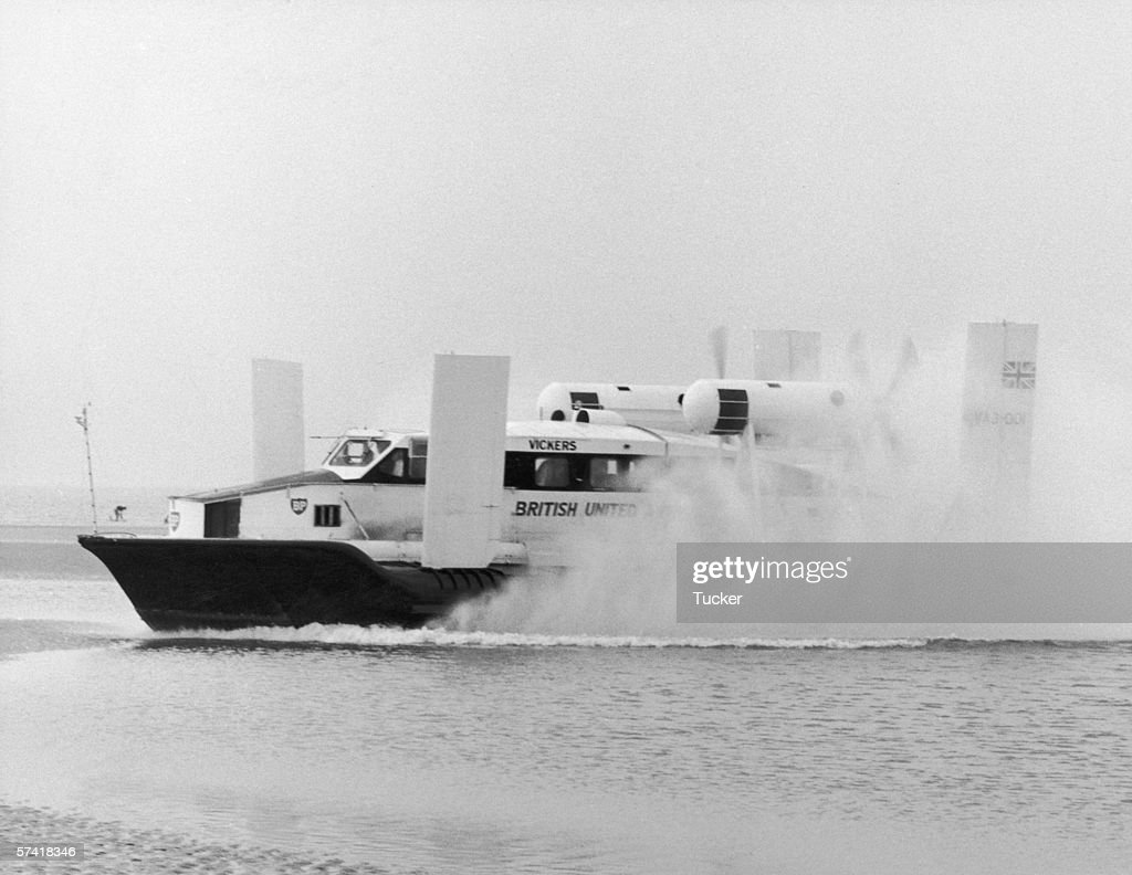 The Vickers Armstrong Hovercraft which will provide a regular service between Rhyl and Wallasey throws up a spray during tests near the beach at Rhyl...