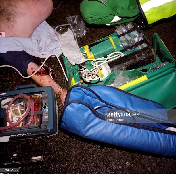 The victim of a suspected drinkdriving accident is attended to by a member of Bristol's rapid response medical team November 2001