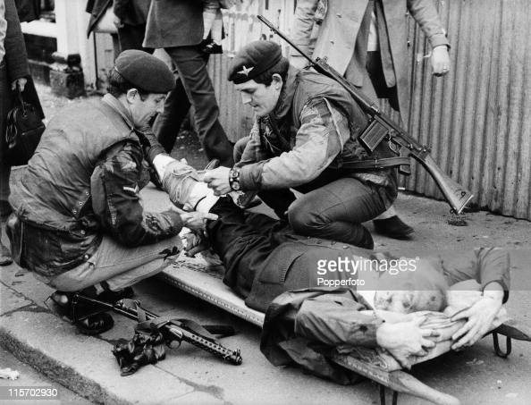 The victim of an IRA bomb blast which killed six and injured 146 is treated by men of the 2nd Battalion Parachute Regiment on Donegall Street Belfast...