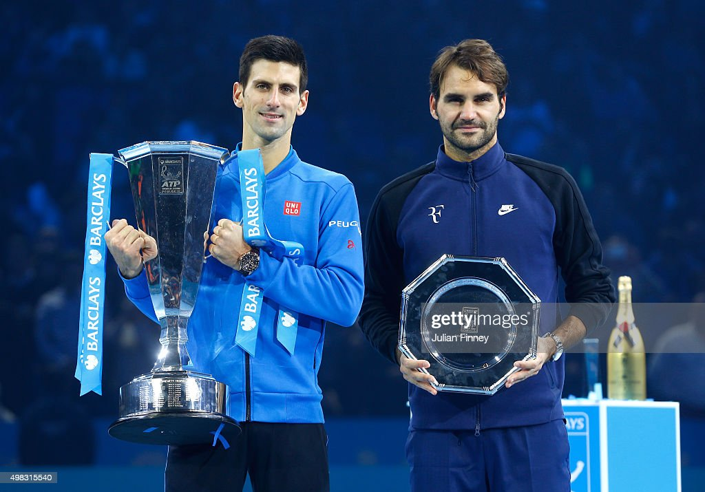 The victor Novak Djokovic of Serbia and runner up Roger Federer of Switzerland pose with their trophies following the men's singles final against on day eight of the Barclays ATP World Tour Finals at the O2 Arena on November 22, 2015 in London, England.