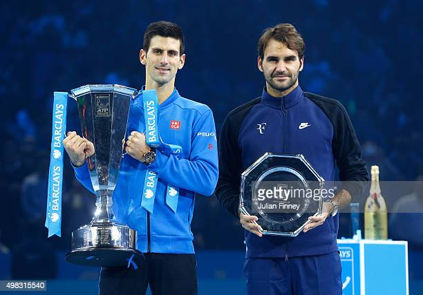 The victor Novak Djokovic of Serbia and runner up Roger Federer of Switzerland pose with their trophies following the men's singles final against on...