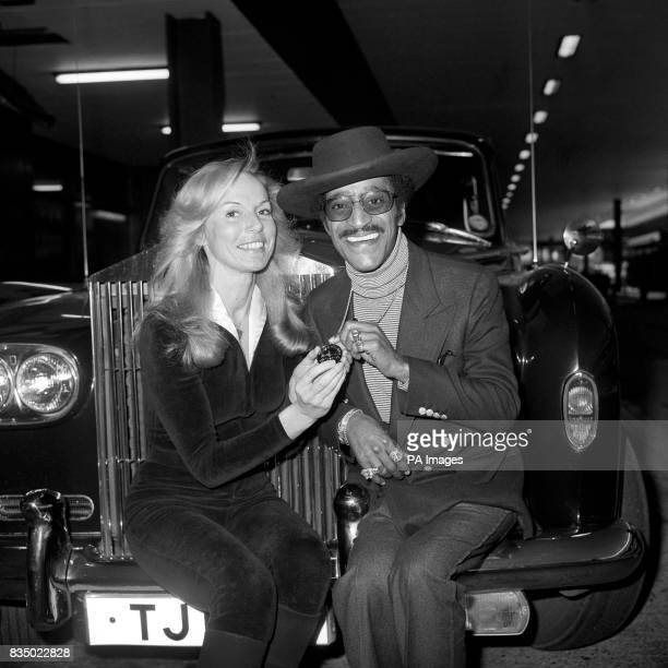 The Victoria Sporting Club's New Award for Talent is presented to Sammy Davis Jr by Georgina Warwick on his arrival at Heathrow Airport for a holiday...
