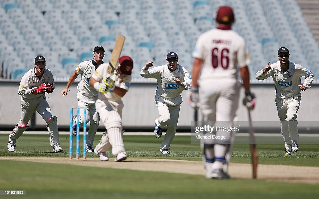 The Victorian Bushrangers celebrate as Chris Hartley of the Queensland Bulls gets caught behind during day one of the Sheffield Shield match between the Victorian Bushrangers and the Queensland Bulls at Melbourne Cricket Ground on February 18, 2013 in Melbourne, Australia.