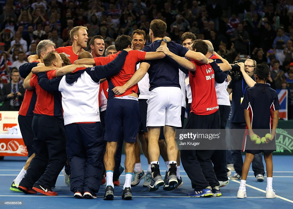 The victorious Aegon GB Davis Cup Team of Andy Murray James Ward Jamie Murray and Dominic Inglot celebrate with support staff during Day 3 of the...