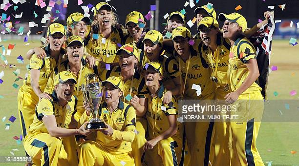 The victorious Australian cricket team poses with their Champion's trophy after winning the ICC Women's World Cup 2013 between Australia and West...