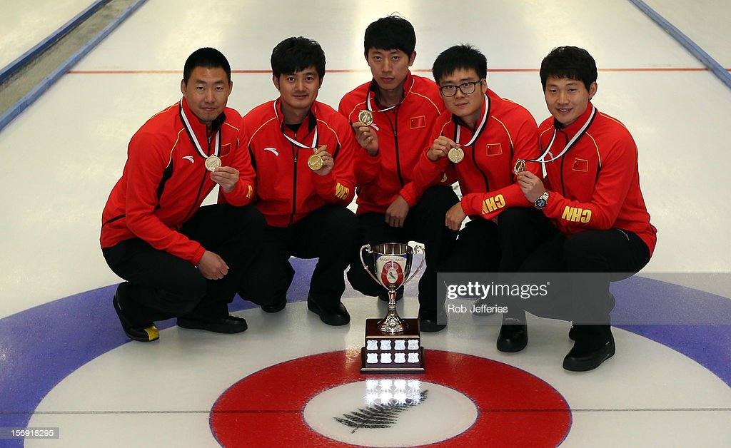 The victorious China team of Rui Liu, Xiaoming Xu, Jialiang Zang, Dexin Ba and Dejia Zou pose for a photo during the Pacific Asia 2012 Curling Championship at the Naseby Indoor Curling Arena on November 25, 2012 in Naseby, New Zealand.