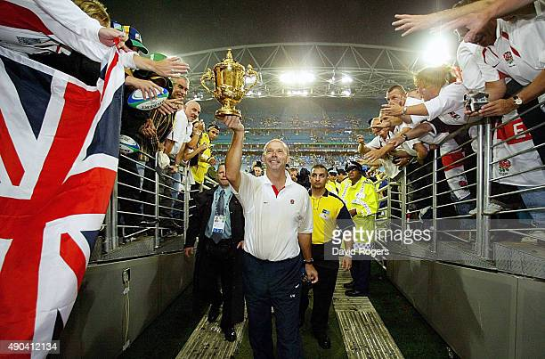 The victorious Clive Woodward head coach of England holds aloft the Webb Ellis cup as he leaves the field after England's victory in the Rugby World...