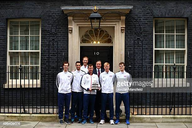 The victorious Davis Cup Great Britain Team Andy Murray James Ward Dom Inglot Captain Leon Smith Kyle Edmund and Jamie Murray pose for a photo with a...