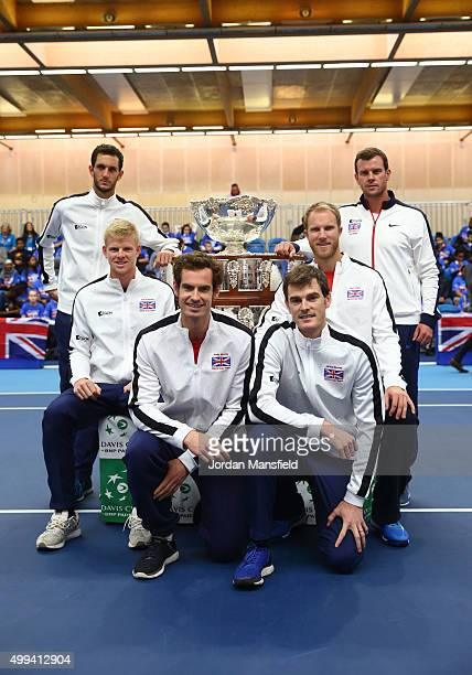 The victorious Davis Cup Great Britain Team James Ward Kyle Edmund Andy Murray Jamie Murray Dom Inglot and Captain Leon Smith pose for a photo with...
