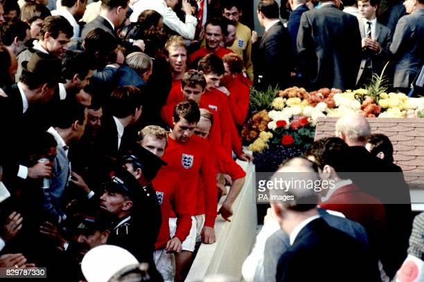 The victorious England players walk down the steps from the Royal Box after being presented with the World Cup Bobby Moore Geoff Hurst Bobby Charlton...