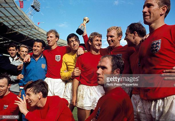 The victorious England team celebrate with the Jules Rimet Trophy after the FIFA World Cup Final between England and West Germany at Wembley Stadium...