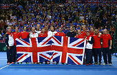 The victorious Great Britain team pose with Union Jack flags following play on day three of the Davis Cup World Group first round tie at the...