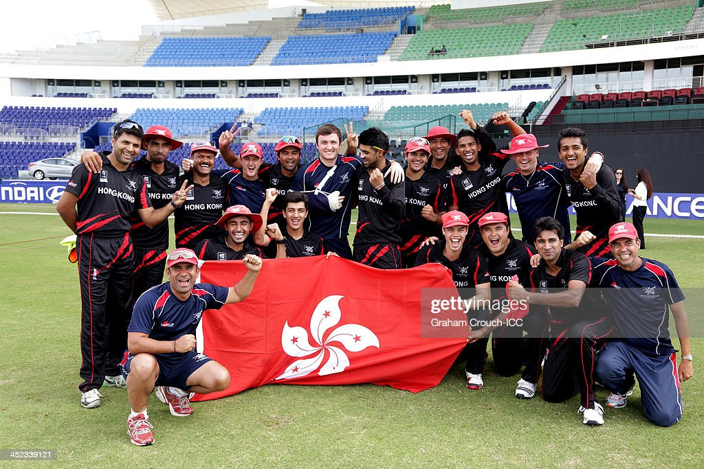 The victorious Hong Kong team following their victory in the Papua New Guinea v Hong Kong Quarter Final match at the ICC World Twenty20 Qualifiers at the Zayed Cricket Stadium on November 28, 2013 in Abu Dhabi, United Arab Emirates.